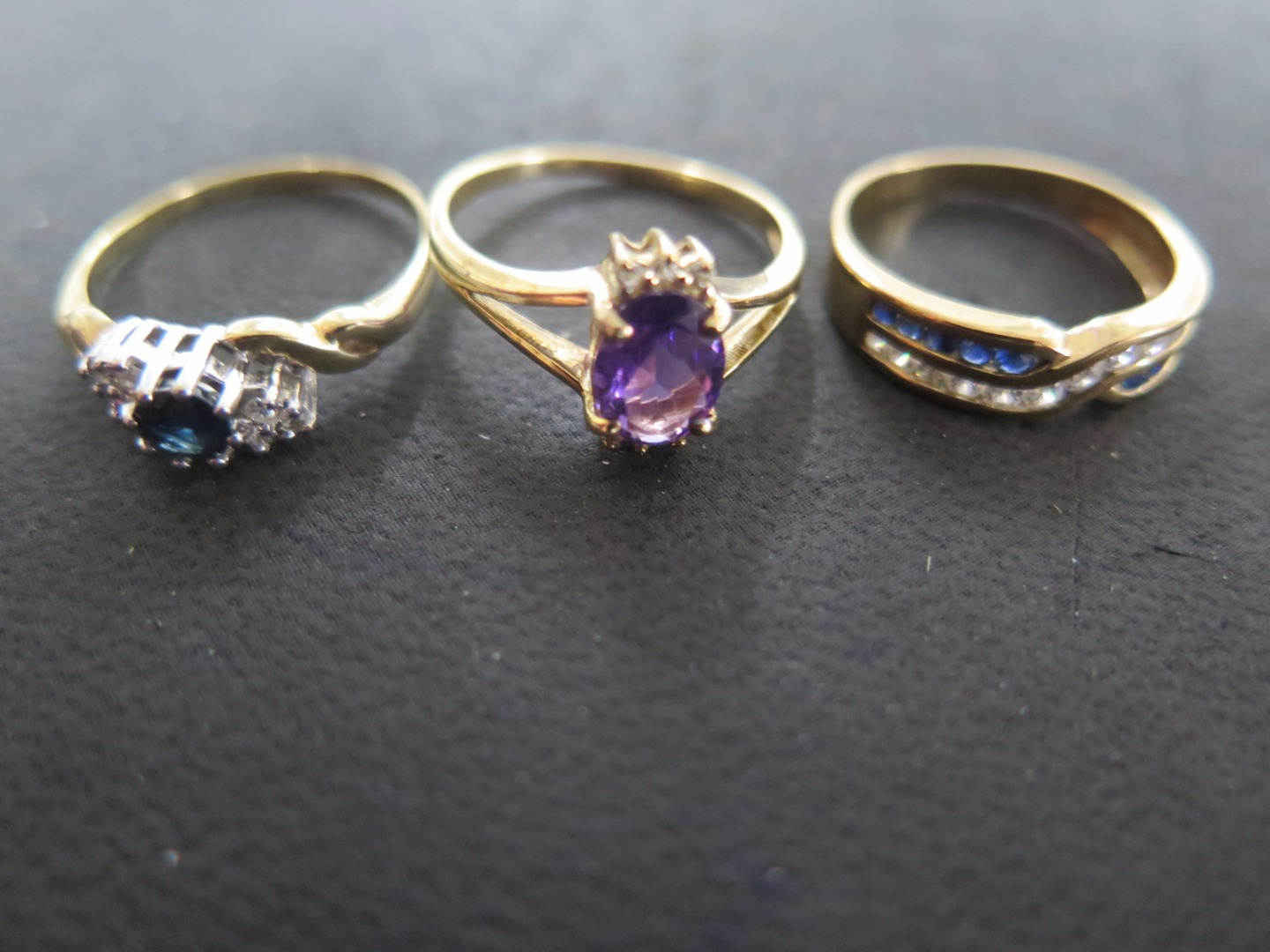 Three 9ct Yellow Gold Dress Rings - one Sapphire flanked by six small...