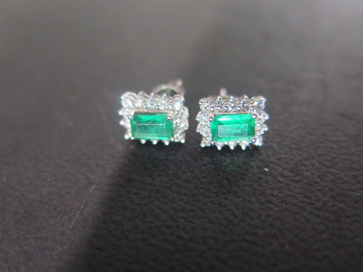 A pair of 14ct white gold emerald and diamond earrings - approx weight 1.9...