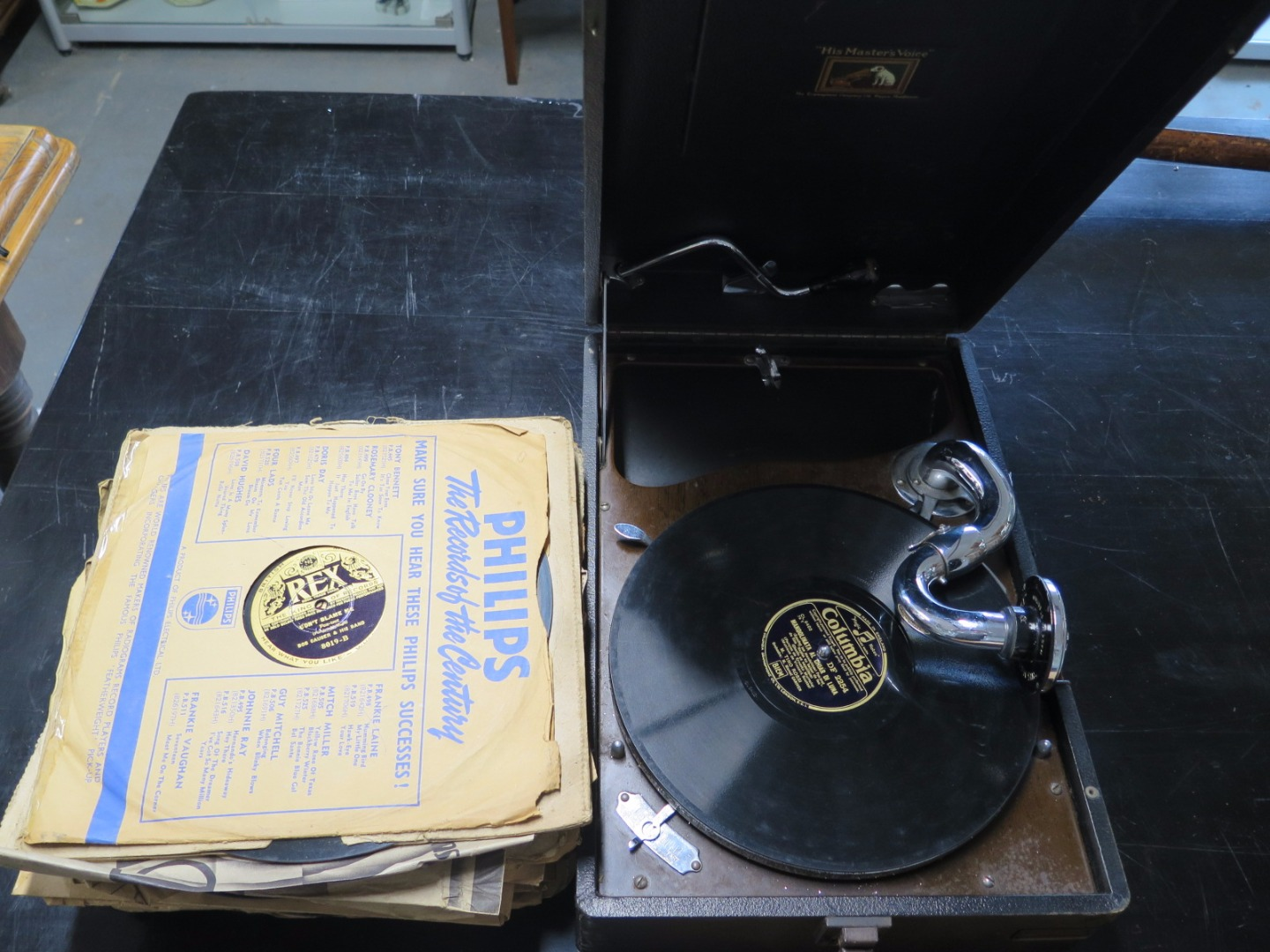 An HMV portable gramaphone with box of 78 rpm records - in working order