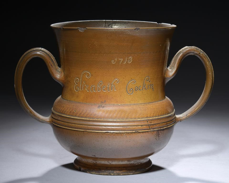 AN EARLY NOTTINGHAM OR CRICH  SALTGLAZED BROWN STONEWARE LOVING CUP Image
