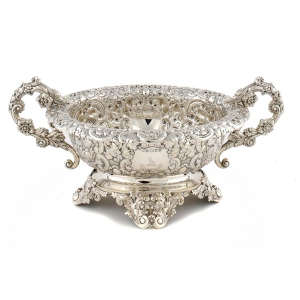 A VICTORIAN SILVER PROFUSELY EMBOSSED TWO HANDLED OVAL CENTREPIECE  52cm w Image
