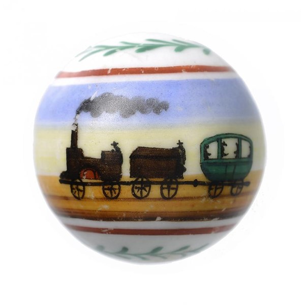 VICTORIAN TOYS. A RARE PORCELAIN MARBLE PAINTED WITH A RAILWAY TRAIN Image