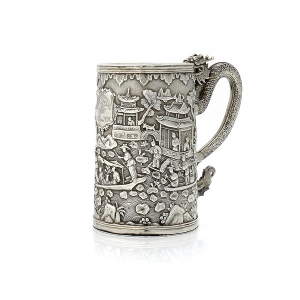 A CHINESE EXPORT SILVER DRAGON HANDLED REPOUSSÉ MUG Image