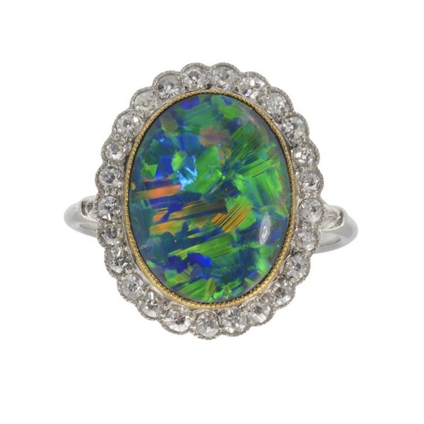 A BLACK OPAL AND DIAMOND CLUSTER RING  in white gold Image