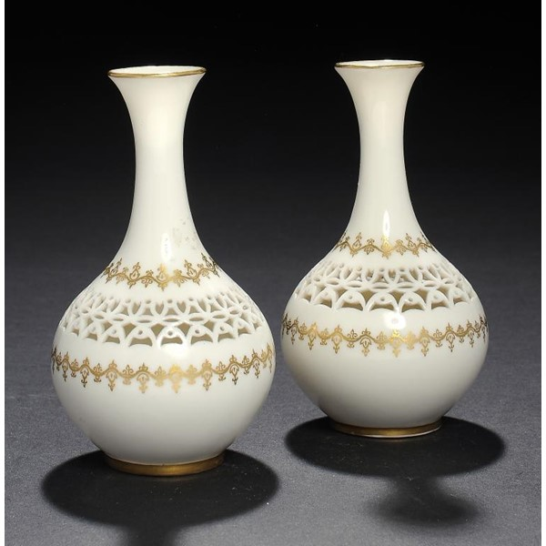 A PAIR OF ROYAL WORCESTER RETICULATED VASES BY GEORGE OWEN Image
