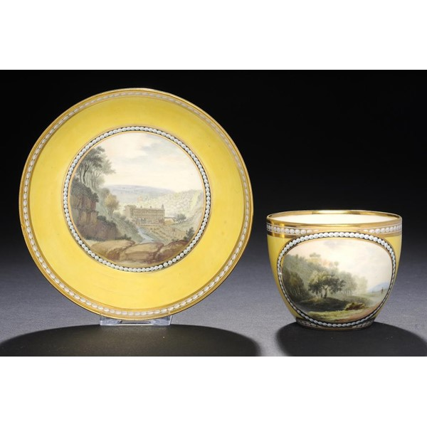 A FINE DERBY CANARY YELLOW GROUND TEACUP AND SAUCER Image