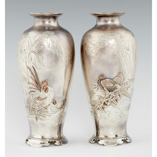 A PAIR OF JAPANESE SILVER AND MIXED METALS VASES Image
