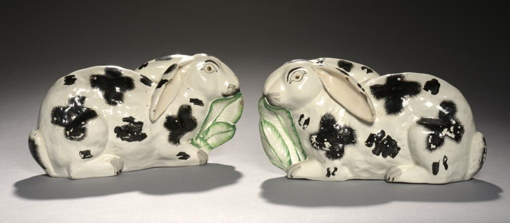 A PAIR OF STAFFORDSHIRE EARTHENWARE MODELS OF RABBITS Image