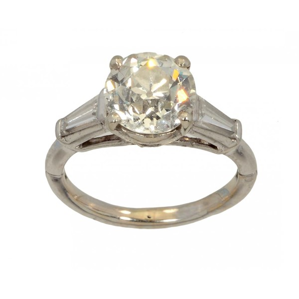 A DIAMOND RING  with round old cut diamond Image