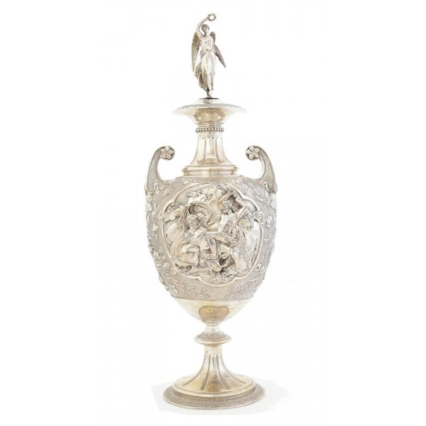 A VICTORIAN SILVER SHIELD SHAPED VASE AND COVER  finely chased in high relief with scenes of warrior Image