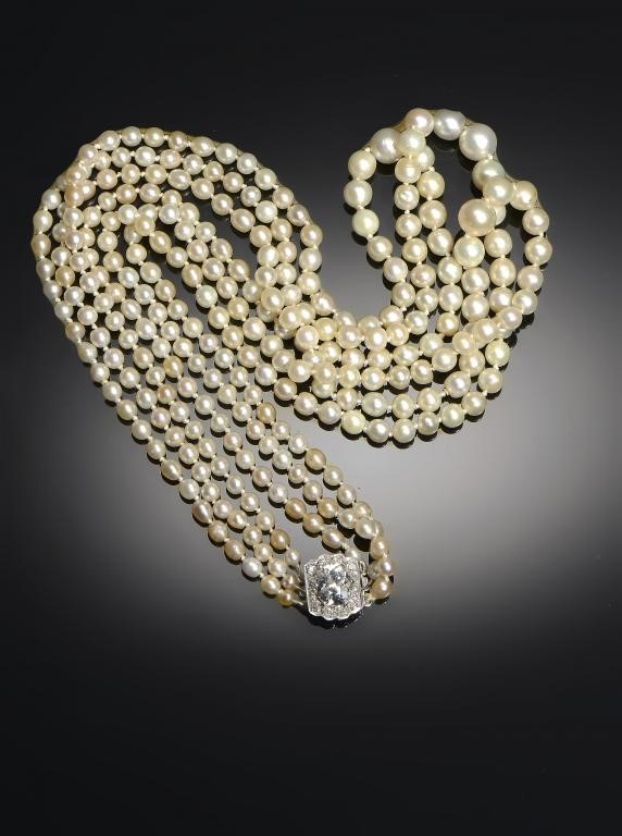 A THREE-STRAND NATURAL PEARL NECKLACE Image