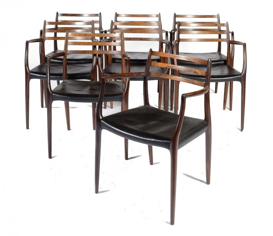 A SET OF EIGHT DANISH ROSEWOOD CHAIRS AND A DINING TABLE DESIGNED BY NIELS O MOLLER AND MANUFACTURED Image